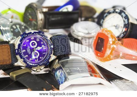 Pile of various wristwatches