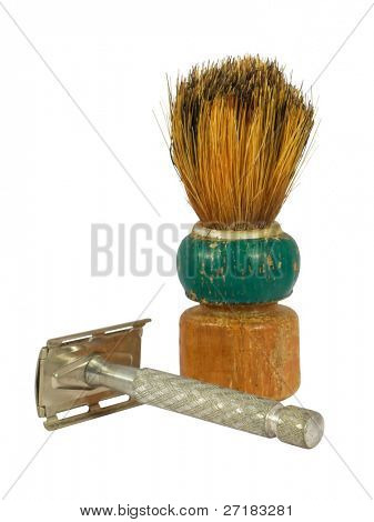 old shaving brush and razor isolated on white