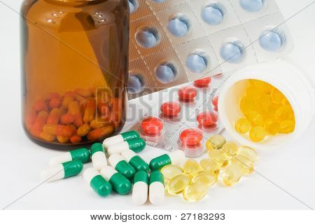 Detail of medicine bottles with spilled pills.