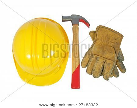 Yellow hardhat, old leather gloves and a hammer isolated on white background