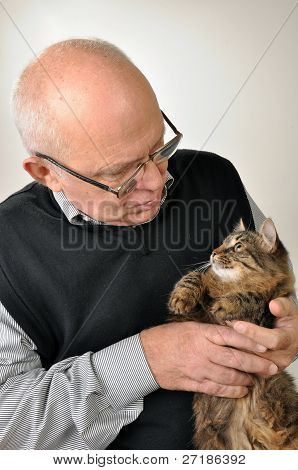 Senior Man With A Cat