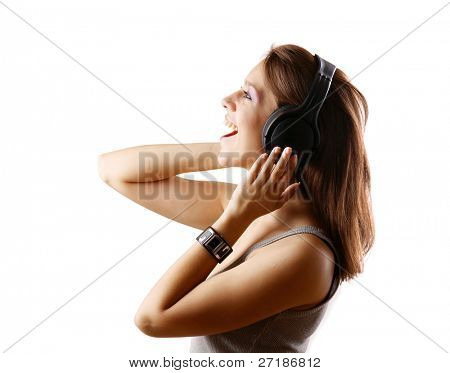 Side view of happy girl in headset singing isolated on grey