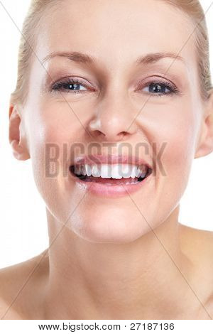 Face of beautiful woman. Smile and teeth. Isolated over white background.