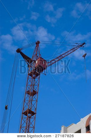 Photo of a tower crane on sky background