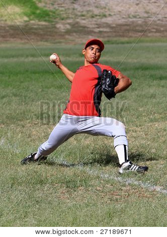 Baseball player throws with strength