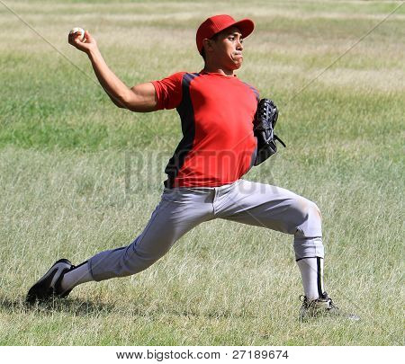 Baseball player throwing with force