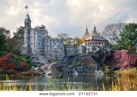 New York City Manhattan Central Park in Autumn with Belvedere Castle and colorful trees over lake with reflection.