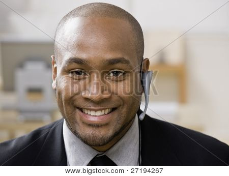 African man with hands-free cell phone device