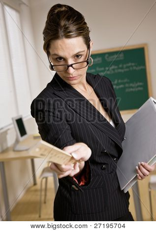 Stern, disciplinarian businesswoman holding ruler and notebook