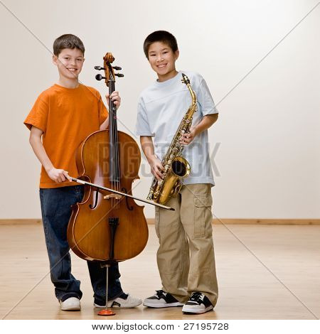 Musicians standing with cello and saxophone