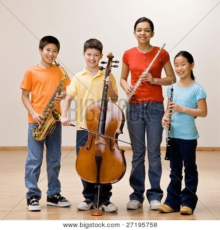Confident musicians holding saxophone, cello, flute and clarinet