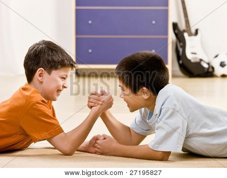 Determined friends arm wrestle