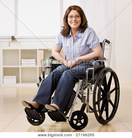 Confident disabled woman sitting in laptop