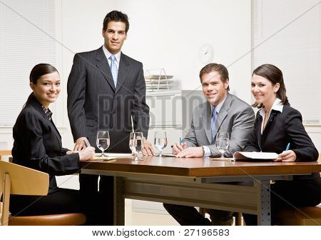 Co-workers and supervisor meeting in conference room