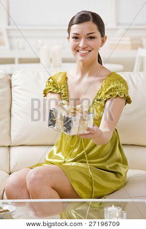 Generous woman offering elegant birthday gift