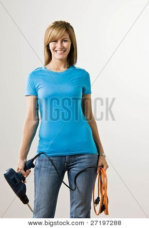 Self-sufficient woman holding drill