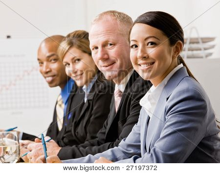 Co-workers listening during meeting in conference room