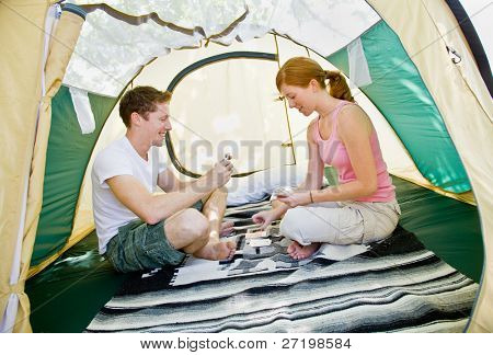 Couple sitting in tent