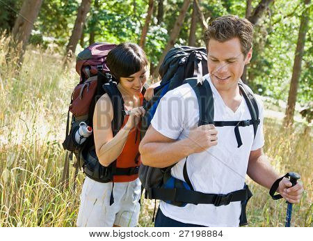 Woman opening boyfriends backpack