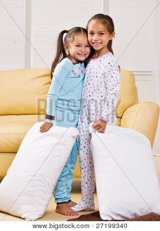 Girls in pajamas in livingroom