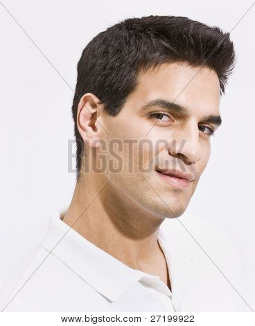 A headshot of a man.  He is smiling and has his face tilted toward the camera. Vertically framed photo.