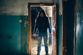 Silhouette Of Criminal Or Maniac With Knife In Hand In Old Scary Building, Serial Killer With Cold W poster