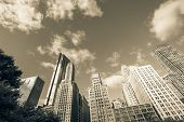 Filtered Image Low Angle View Of Chicago Skyscrapers Under Cloud Blue Sky poster