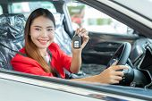 Young Woman Buys A Car With Receiving The Keys Of Her New Car, Photo Of Happy Young Mixed Race Woman poster