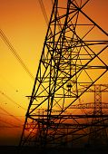 stock photo of electricity pylon  - Electricity Pylon over orange sunset sky - JPG
