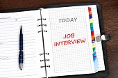 stock photo of interview  - Job  interview on today page - JPG