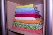 Towels In The Closet On The Shelf, Bright Towels In The Drawer. Order In The House. Everything On Th poster