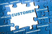 stock photo of loyalty  - Customer blue puzzle pieces assembled - JPG