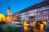Classic Panoramic View Of The Historic City Center Of Erfurt With Famous Krämerbrücke Bridge Illumin poster