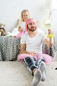 Adorable Little Daughter Playing With Happy Father In Pink Wig And Tutu Skirt Looking At Mirror poster