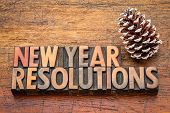 New Year  resolutions word abstract in vintage letterpress wood type again rustic wooden board with  poster