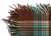Brown-green checkered tartan wool blanket with fringe isolated on white