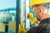 Windows Installer Job. Caucasian Men Wearing Yellow Hard Hat Testing Newly Installed Window. Constru poster