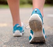 pic of shoe  - Close up motion shot of person walking away in running shoes - JPG