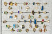 A Lot Of Rings Jewelery In Different Colors And Gems On A Plate In Jewelery Ring Gallery. Rings With poster
