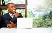 stock photo of upcoming  - Successful African businessman thinks about his upcoming project - JPG