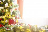 Elegant Christmas Tree With Decorations And Gifts On Elegant Hardwood Floor Over Window poster
