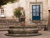 stock photo of hacienda  - Small Courtyard Plaza with Fountain at end of Walking Street Morelia Mexico  - JPG