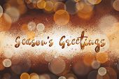 Seasons Greetings Text, Handwritten Golden Sign At Christmas Shiny Gold Background Of Glitter Spark poster