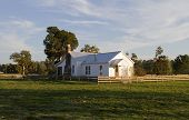 stock photo of farm-house  - An old house on the prairie in late afternoon light - JPG