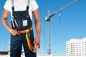 erector closeup on building background poster