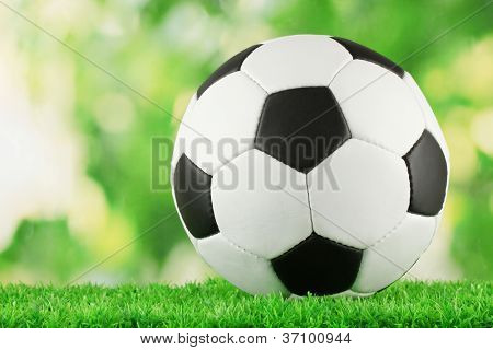 football ball on green grass