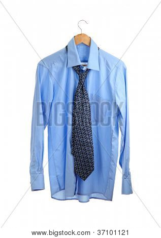 blue shirt with tie on wooden hanger isolated on white