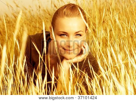 Image of pretty cute woman on wheat field, sweet lovely female enjoying freedom in countryside, golden hay meadow, autumn nature, attractive blond girl on wheat rye background, grain harvest season