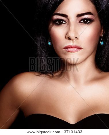 Picture of beautiful attractive girl, closeup portrait of elegant arabic woman with dark hair isolated on black background, female with perfect tanned skin, luxury and beauty concept