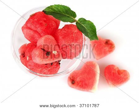 Watermelon ice cream in a glass  and hearts of watermelon on white background close-up